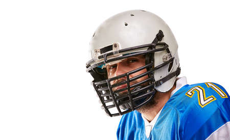 Concept american football, portrait of american football player in helmet with patriotic look. Black white background, copy space. Stock Photo