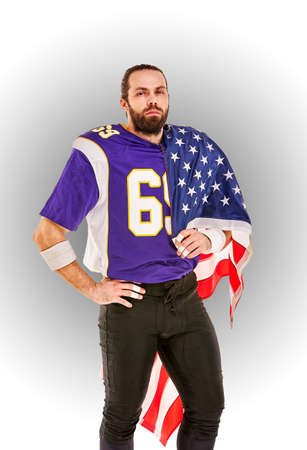 American football player closeup portrait. American football player with an american flag in his hands. Concept patriotism, celebration.