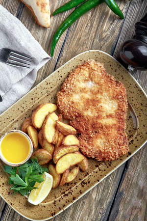 Tasty schnitzel with boiled potato. Top view, flat lay food 版權商用圖片