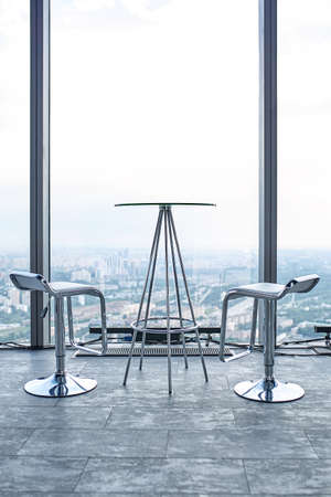 Concept talk with God. A platform on a high-rise building, a table and two chairs overlooking the sky and the city. 版權商用圖片