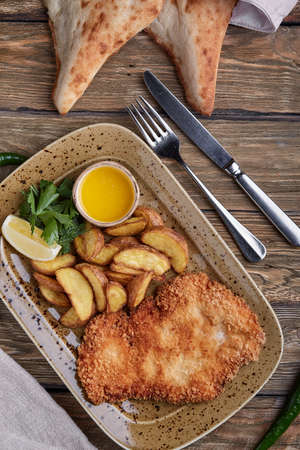 Tasty schnitzel with boiled potato. Top view, flat lay food Imagens