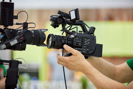 Behind the scenes of video production or video shooting. The concept of production of video content for TV, blog, shows, movies. Cameras prepared for video filming Imagens