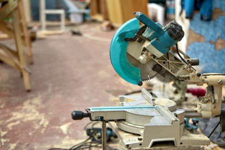 Close-up of a laser circular saw at a construction site. Products for home and garden and production. Building tool.