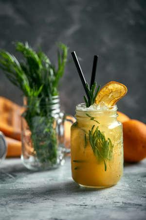 Refreshing summer drink. Ingredients: tarragon, lemon, soda, sugar. Lemonade with tarragon. Real concept, cocktail workspace.