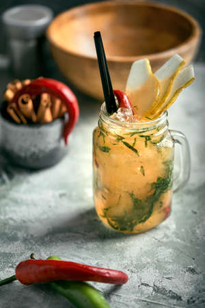 Summer lemonade pear with pepper. Refreshing summer drink with ice. Real concept, cocktail workspace. 版權商用圖片