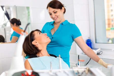 Amazing smile Top view of dentist examining his beautiful patient in dentist s office