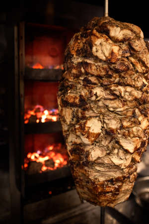 Close up shot of stacked meat roasting to be used in preparation of traditional Greek dish gyros or Turkish durum doner. shawarma Stock Photo