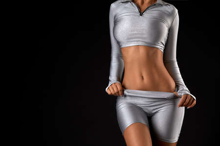 Close up of female relax body without a face taking off cloths Фото со стока