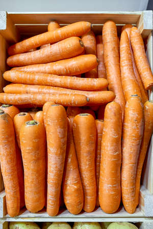 fresh winter carrots in and around a wooden box on a Stock fotó