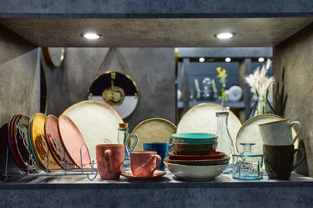 a showcase with the laying of porcelain dishes. Beautiful merchandising, dishes for restaurants and hotels.