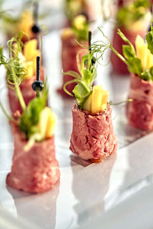 Delicious canapes beef with pineapple. Concept of food, restaurant, catering, menu.