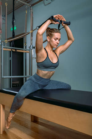 Palates trainer girl posing for a reformer in the gym. Fitness concept, special fitness equipment, healthy lifestyle, plastic. Copy space, sport banner for advertising. Stock Photo