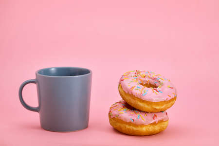 Colorful Donuts Breakfast Composition with Different Color Styles. Game of color, sweet life. Copy space, pink background