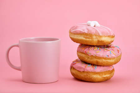 Colorful Donuts Breakfast Composition with Pink Color Styles. Game of colors, pink on pink. Sweet life, vanilla breakfast