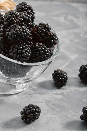 on a black background, close-up, fresh berry in a gourd on a concrete background. copies of the space.