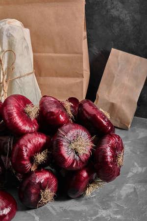 Red organic onion. Farm eco vegetables. Dark background. 스톡 콘텐츠