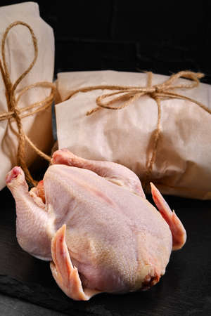 Fresh chicken carcass on a gray background, fresh meat, copy space, photo for grocery stores. dark background. Фото со стока