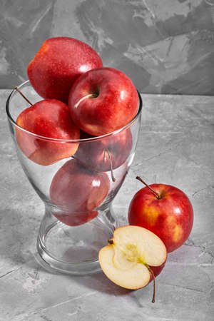 Red apples on the table. Top view with copy space on gray stone background. Stockfoto