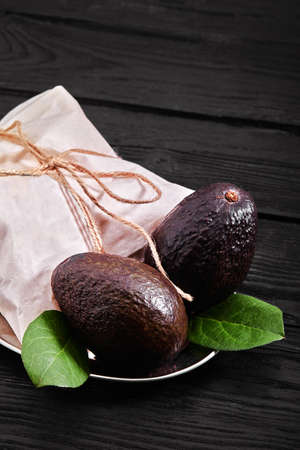 Ripe Haas Avocado Fruit. Alligator pear. Avocado with black peel. Foods for proper nutrition. Products for a diet.