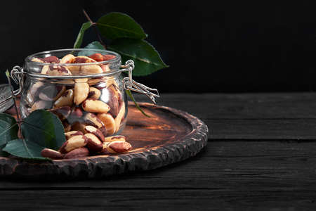 Open jar filled with Brazil nuts close up 免版税图像