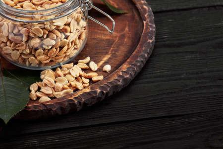 Deep fried peanuts on dark table background 免版税图像