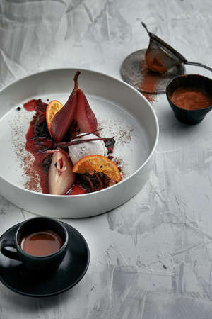Poached pear with an ice cream in red wine sauce Archivio Fotografico