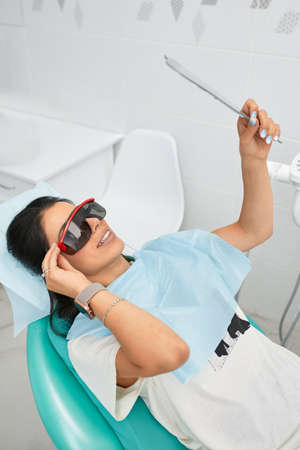 Overview of dental caries prevention.Woman at the dentists chair during a dental procedure. Beautiful Woman smile close up. Healthy Smile. Beautiful Female Smile