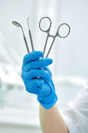 Close-up of dentists hands and dental equipment