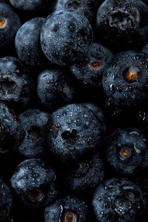 Fresh natural antioxidant blueberries pile, macro detailed close up