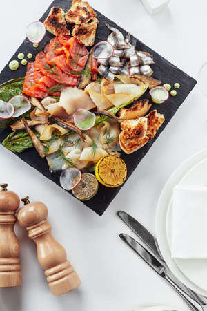 seafood platter. Assorted delicious seafood with vegetables. White background Banco de Imagens