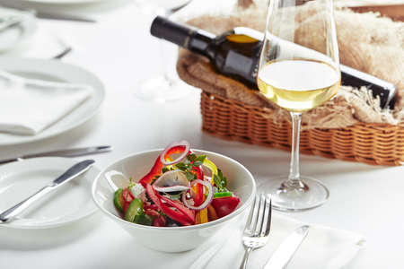 Classic Greek salad. Banquet festive dishes. Gourmet restaurant menu. White background.