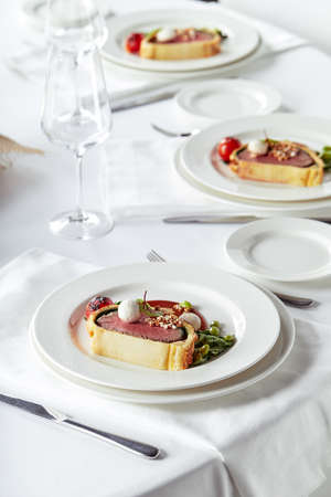 Easter meat roll, meatloaf for Easter dinner. Beautifully decorated catering banquet table with different food snacks and appetizers