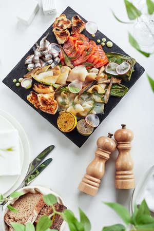 seafood platter. Assorted delicious seafood with vegetables. White background 스톡 콘텐츠