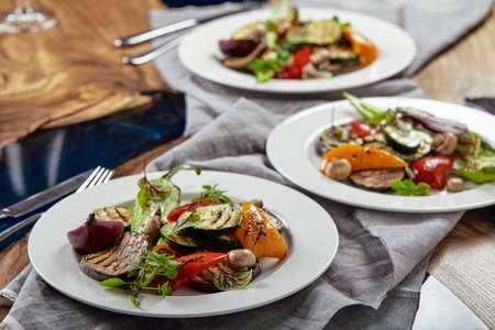 Grilled vegetables on a white plates. restaurant