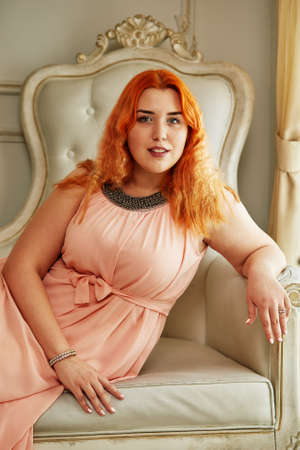 Plus size fashion model, fat woman on luxury interior, overweight female body, professional make-up and hairstyle