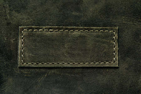 Elegant dark olive leatherette background. Leather texture. Free space for text. Imagens