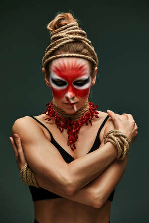 fashion portrait of pretty young woman with creative make up like a animal, fashion victim. Animal flow