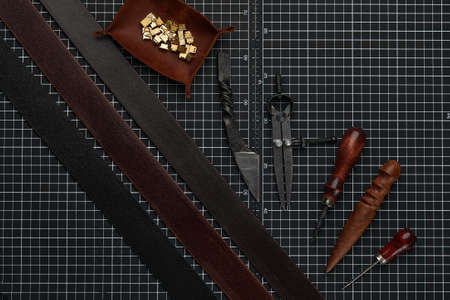 Tools for leather crafting and pieces of eather. Manufacture of leather goods. Reklamní fotografie