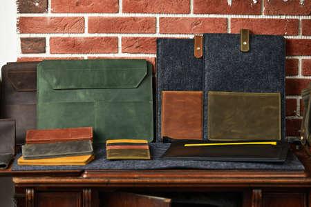 Set of handmade leather goods, key holder rings, wallet, purse, notepad, handbook. Handcrafted leather goods, close-up Reklamní fotografie