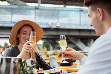 couple having amazing lunch and drink champagne at outdoor restaurant