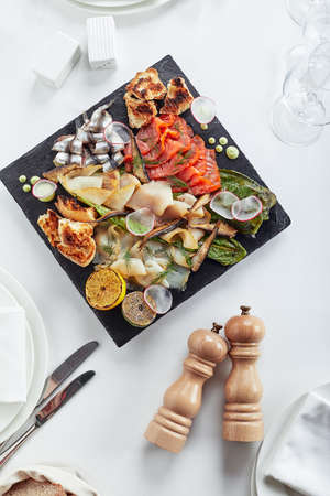 seafood platter. Assorted delicious seafood with vegetables. White background Reklamní fotografie