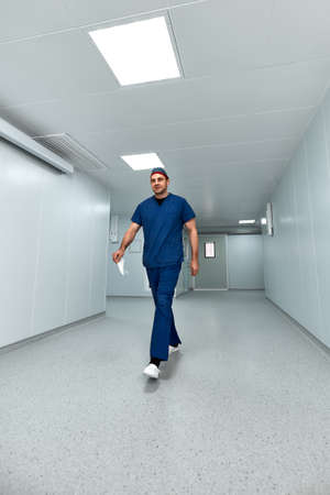 Male surgeon goes to the surgery in the clinic. Set up for major surgery