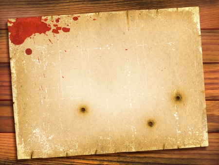 bloodied: Old paper texture with red blood on wood background.Retro Stock Photo