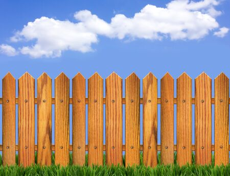 pasture fence: Wood fence and blue sky horizon  Background for design