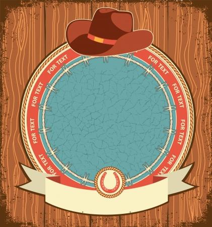 country western: Fond de l'�tiquette de l'Ouest avec un chapeau de cow-boy sur la texture de vieux bois