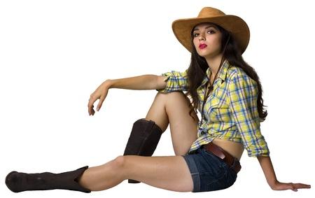 若い騎乗位。カウボーイ ハットと白で隔離の靴で美しい少女