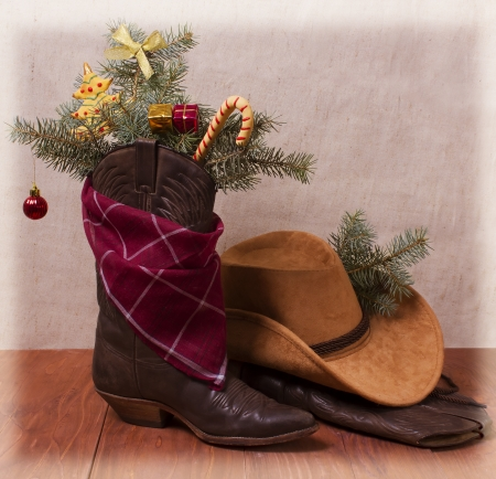 American cowboy shoes and hat with Christmas decorations