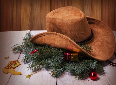 Cowboy western hat and Christmas decoration on wood background card Stock Photo
