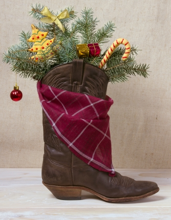 American West leather cowboy boot with Christmas decoration photo