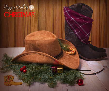 Christmas image with cowboy hat and boot on wood background Stock Photo